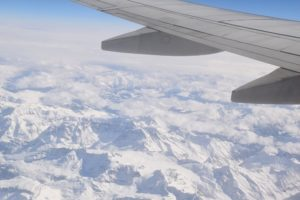 Plane flying over snowy mountains